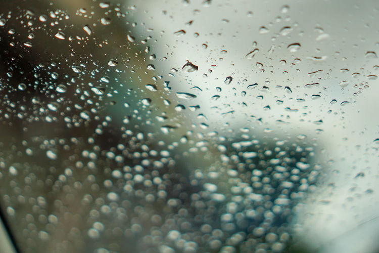 blur backgruond,Rain water on the car glass Abstract Background Backgrounds Blue Bubble Car Clean Clear Close Closeup Color Driving Drop Drops Glass Light Liquid Moisture Nature Night Pattern Rain RainDrop Rainy Reflection Season  Shape Storm Surface Sweat Texture Traffic Up View Water Weather Wet White Window Windshield Wiper Glass - Material Transparent Indoors  Full Frame Close-up No People Rainy Season Selective Focus Mode Of Transportation Vehicle Interior
