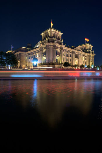 Lake by reichstag building at night