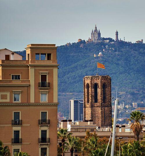 Catalonia Flag Against Tibidabo Mountain In City