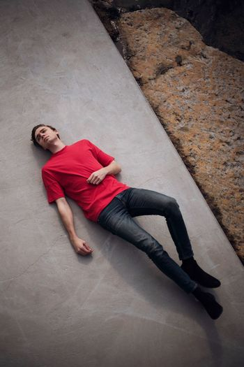 Dreamer Portrait Lines Model One Person Full Length Adult Young Adult High Angle View Casual Clothing Young Men Red City Concrete Lying On Back Brown Hair Men Day Relaxation Lying Down