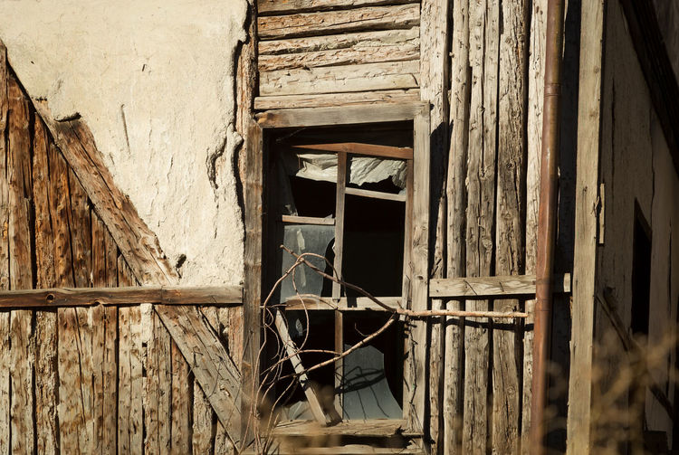 Withered Away Architecture Building Exterior Built Structure Close-up Deterioration Outdoors Planks Planks Of Wood Rotted Wood Rotting Wood Torn Window Withered  Wood Wood - Material