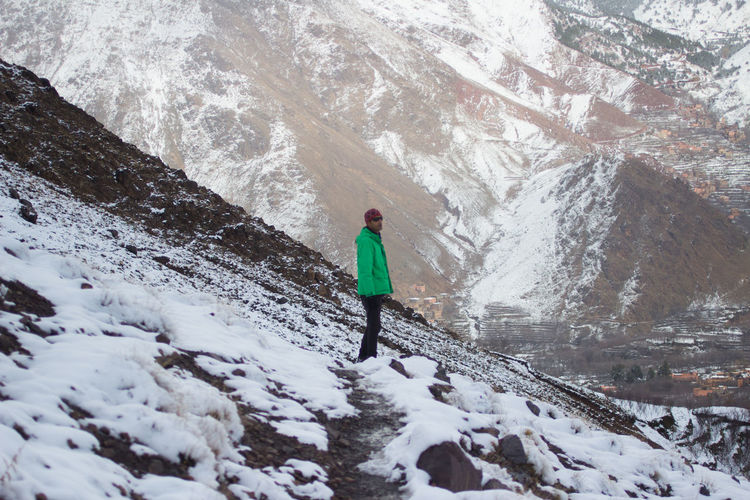 High angle view of man standing on snowy mountain