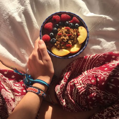 Low Section Of Woman Holding Bowl With Breakfast At Home