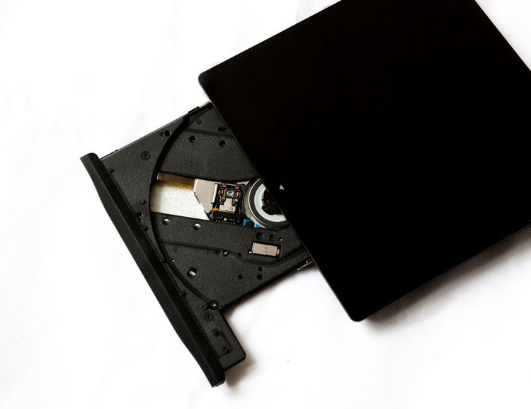 Burning Compact Disc External Tray Writer Accessories Black Color Cd Close-up Digital Disk Drive Dvd Disk Hardware No People Open Portable Studio Shot White Background