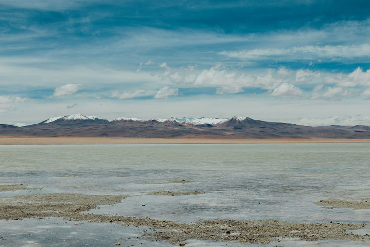 Altiplano Beauty In Nature Bolivia Cloud - Sky Clouds And Sky Day Flat Lake Landscape Mountain Mountain Range Nature No People Outdoors Salar Salt - Mineral Salt Flat Scenics Sky Snow Tranquil Scene Tranquility Wanderlust Water