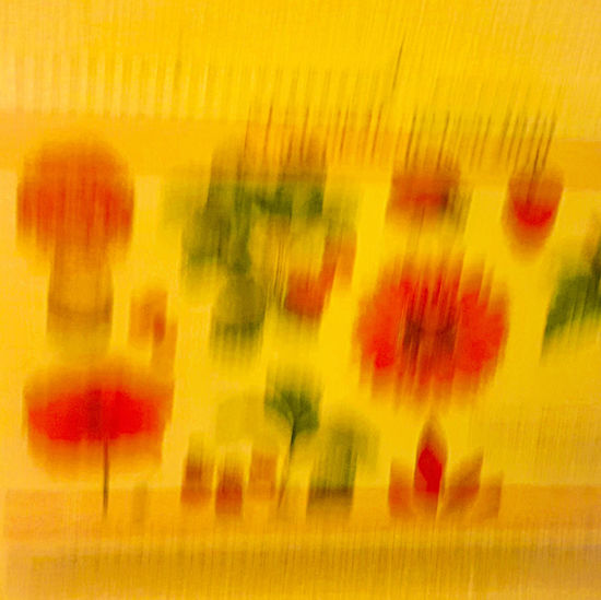Full frame shot of glass with flowers against blurred background