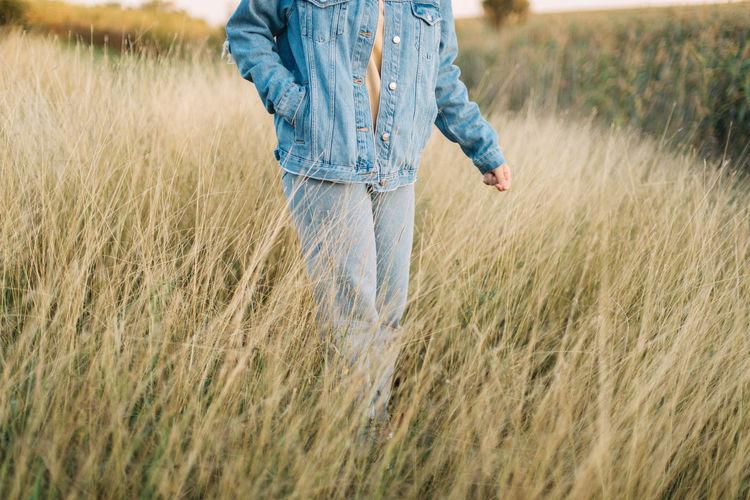 Full length of man walking in field