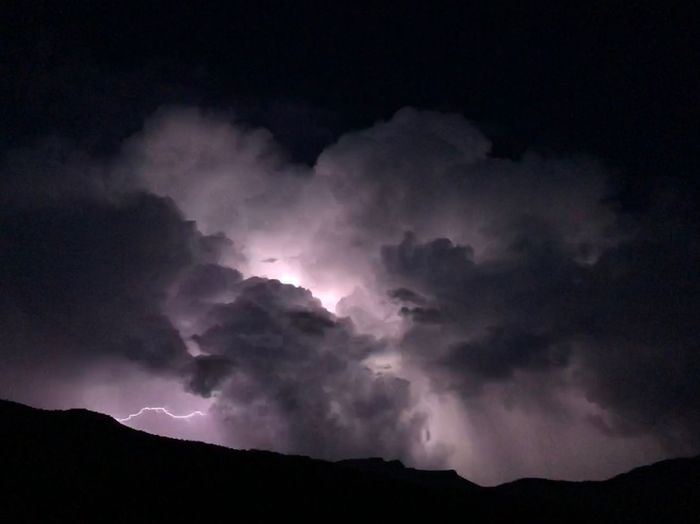 Sky Beauty In Nature Cloud - Sky Mountain Storm Scenics - Nature Lightning Night Power In Nature Tranquil Scene Environment Power Silhouette Low Angle View Outdoors No People Ominous Nature Tranquility Storm Cloud