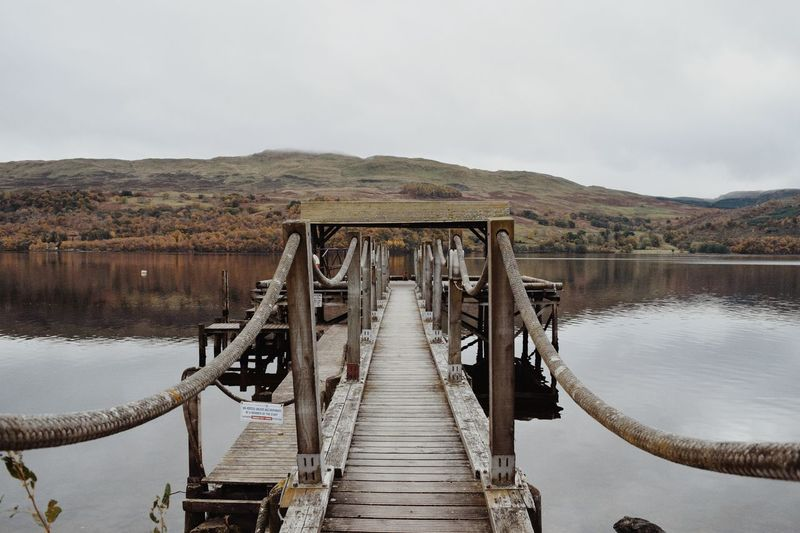 Solitude walk on the pier Water Bridge - Man Made Structure Lake Connection Nature Tree Sky Outdoors EyeEm Landscape No People Day Reflection Lake Loch Tay Scotland Autumn🍁🍁🍁 Beauty In Nature Scotlandsbeauty Loch  Lost In The Landscape