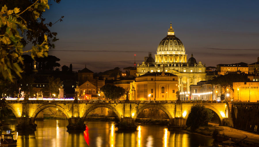 St. Peter's Cathedral in Rome, Italy, and the Tiber River against dark sky at blue hour after sunset. Architecture Built Structure Illuminated Water Bridge Travel Destinations Night Building City No People Arch Bridge Rome Italy Vatican Vaticano San Pietro Basilica Basilica Di San Pietro In Vaticano St Peters Basilica Tiber Tiber River Blue Hour Sunset Golden