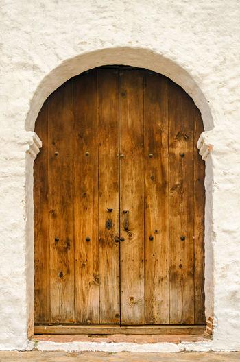 Closed Wooden Door Of Historic Church