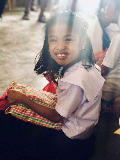 Give gifts, give smiles. Eyeem Philippines EyeEm Selects EyeEmNewHere EyeEm Best Shots Christmas Gifts Kids Girls Lifestyles Happiness Outdoors Leisure Activity Portrait Day Celebration