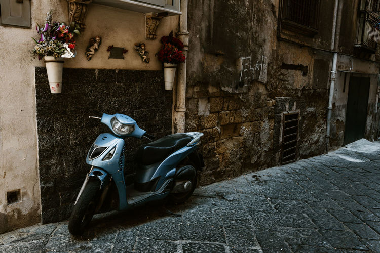 Streets of Napoli, Italy Architecture Built Structure Street Building City Mode Of Transportation Scooter Building Exterior Day No People Motor Scooter Transportation Motorcycle Outdoors Land Vehicle Footpath Old Cobblestone House Wall Naples, Italy Napoli Naples