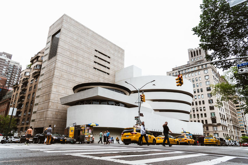 Solomon R. Guggenheim Museum in New York Architecture Day Manhattan NYC NYC Street Photography America American Architecture Solomon R. Guggenheim Museum Museum Frank Lloyd Wright Frank Lloyd Wright Architecture Guggenheim Guggenheimmuseum Guggenheim Nyc Travel Travel Destinations Tourism Tourist Attraction  City Car Transportation Building Exterior Mode Of Transportation Motor Vehicle Built Structure Street Land Vehicle Sky Road City Street Incidental People City Life Nature Building Taxi Clear Sky Office Building Exterior Skyscraper