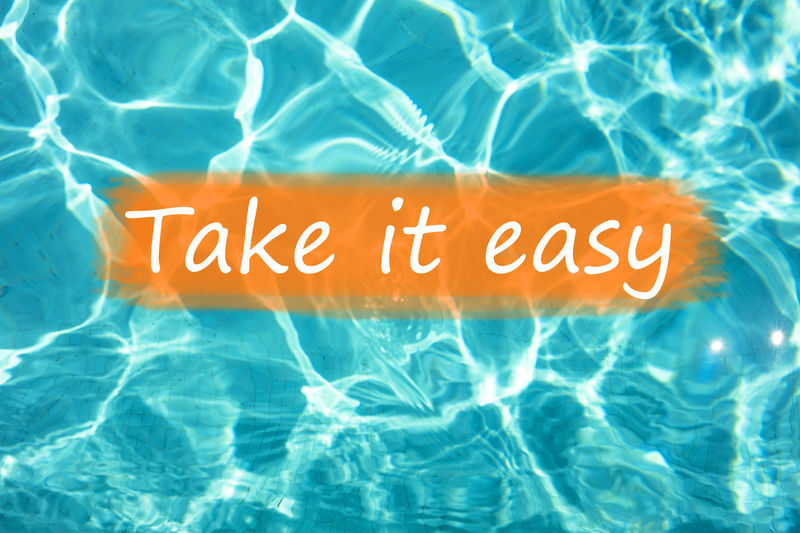 """Detail of word """"Take it easy"""" on swimming pool water and sun reflecting on the surface. Freshness Fun Holiday Holidays Postcard Reflection Summertime Swimming Text Background Backgrounds Blue Communication Enjoyment Fresh Leisure Activity Pool Relax Relaxation Summer Swimming Pool Take It Easy Text Wallpaper Water"""