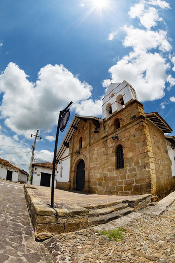 A fisheye shot of a chapel in Giron, Colimbia. Basilica Check This Out Church Colombia Exterior Latin America Santander Sunny Travel Architecture Bucaramanga Cobblestone Colombian  Colonial Destination Fisheye Girón Historic Low Angle View No People Outdoors Place Of Worship South America Sunlight Tourism