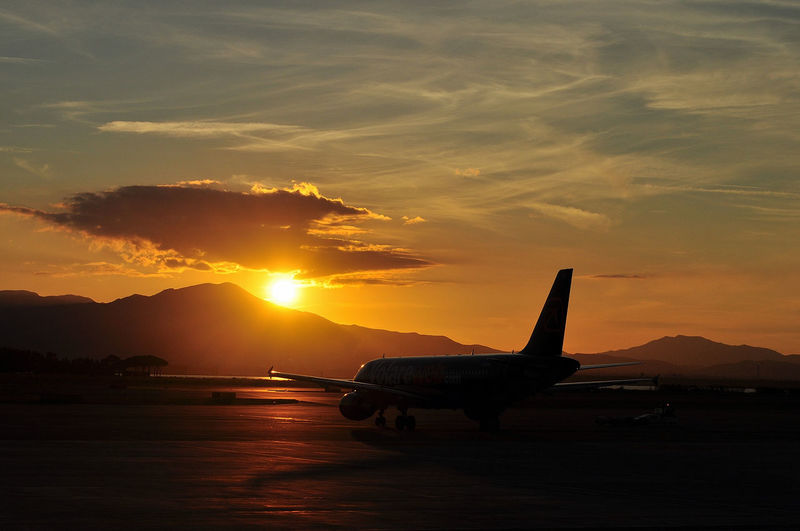 Cagliari Elmas airport. Elmas Sunlight Sunset Silhouettes Air Lines Air Vehicle Airplane Cloud - Sky Mode Of Transport Nature No People Orange Color Runway Sardegna Sardinia Silhouette Sky Sun Sunlight Sunset Sunshine Transportation A New Beginning