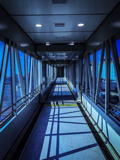 Empty passenger boarding bridge at airport