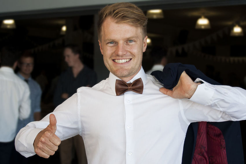 Blond Hair Bow Tie Day Excited Formalwear Groom Happy Indoors  Joy Leather Looking At Camera Love Marriage  Men People Portrait Smiling Standing Tuxedo Wedding Wedding Day Wedding Photography Young Adult Marriage  Excitement