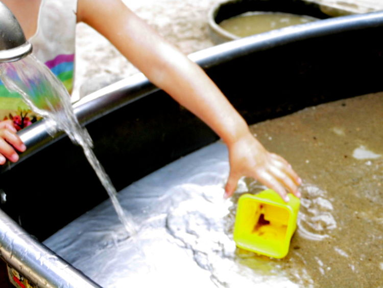 Childhood Close-up Holding Leisure Activity Lifestyles Outdoors Part Of Playing With Water Water Yellow