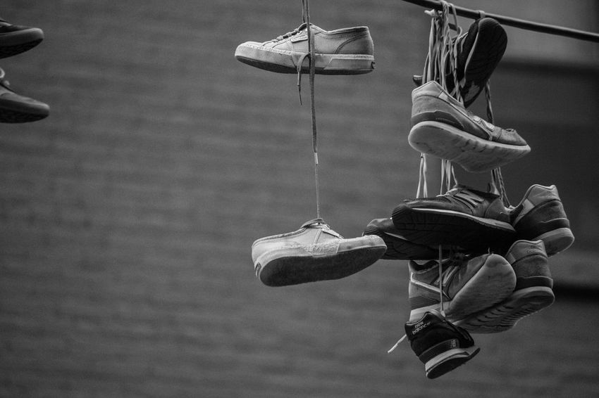 Issa Khari.com Outdoors Sneakers Shoes Power Line  Day NYC Issakhari New York City Black And White Photography City Focus On Foreground Canon Canon 7D MarkII EyeEmNewHere Power Lines Power Attached Cable Sneaker The Street Photographer - 2017 EyeEm Awards EyeEmNewHere