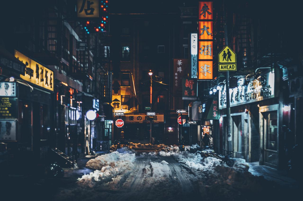 Illuminated City Street At Night During Winter