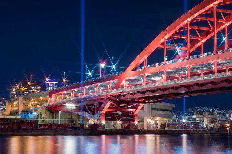 Illuminated Kobe Ohashi Bridge Over River At Night