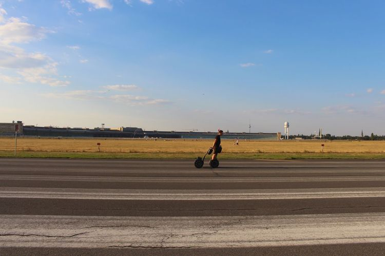 A Segway'er on the (former) airstrip of Tempelhofer Feld Blue Sky Leisure Activity Mode Of Transport Outdoors Real People Scenics Segway Sky Summer Summertime Sunny Day Tempelhof Tempelhofer Feld Tranquil Scene Transportation