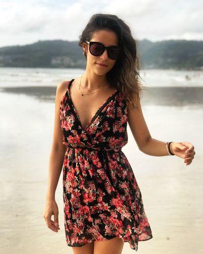 Portrait of beautiful young woman wearing sundress at beach