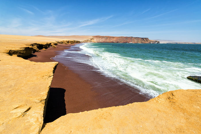 Red sandy beach called Playa Colorada near Paracas, Peru America Countryside Desert Destination Dirt Dry Dust Famous Landmark Landscape National Park Nature Nature Ocean Outdoors Paracas Peru Pothole Reserve Rocks Sand Scenery Scenics South America View