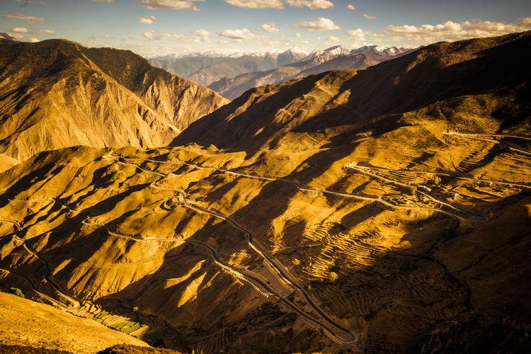 Road winding through mountain in tibet china.