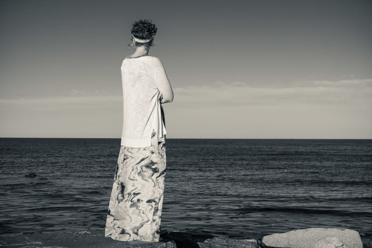 Sea Water Horizon Sky Horizon Over Water Standing One Person Beauty In Nature Scenics - Nature Nature Rear View Day Adult Three Quarter Length Land Beach Young Adult Tranquility Hairstyle Contemplation Looking At View Woman
