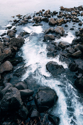 Scenic view of rocks at sea shore