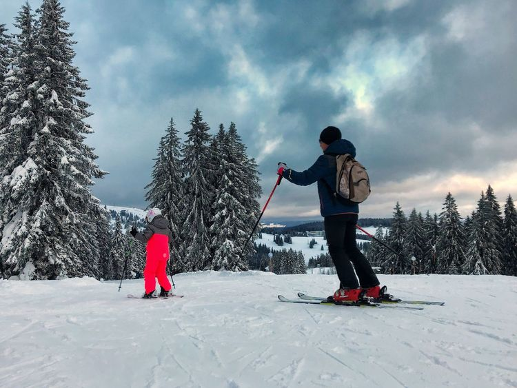 Winter Snow Cold Temperature Childhood Real People Two People Cloud - Sky Weather Lifestyles Leisure Activity Nature Full Length Father Boys Warm Clothing Togetherness Day Sky Fun Beauty In Nature