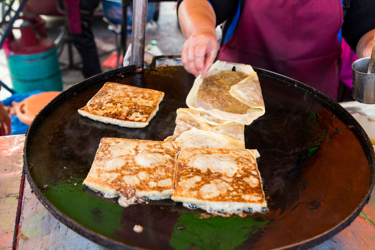 Murtabak, popular food in Malaysia especially during iftar or fasting month for Muslim Cooking Iftar Malaysian Food Asian Food Cooking Pan Flour Food Food And Drink Human Body Part Human Hand Meat Murtabak Muslim One Person Preparation  Street Food