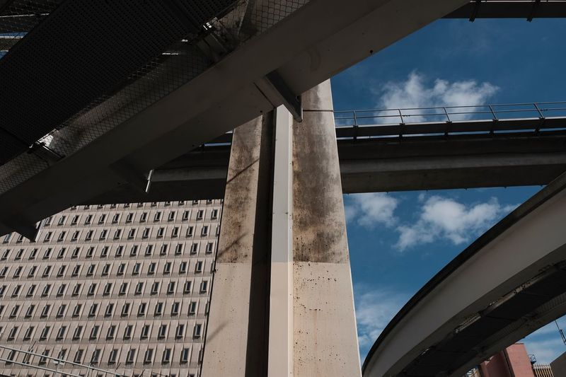 Urban Development Photographyisthemuse Monorail  Railway Track Built Structure Architecture Sky Cloud - Sky Building Exterior Low Angle View Day No People Outdoors City Transportation Underneath Sunlight Architectural Column Pattern Connection