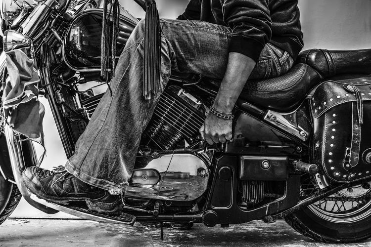Low section of man sitting on motorcycle