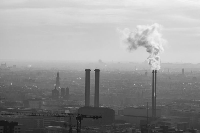 foggy panorama of Berlin Building Exterior Smoke Stack Smoke - Physical Structure Pollution Architecture Factory Environmental Issues Built Structure Industry Environment Emitting Air Pollution Sky City Fumes Nature Chimney Social Issues No People Ecosystem  Atmospheric Cityscape Outdoors Smog Berlin