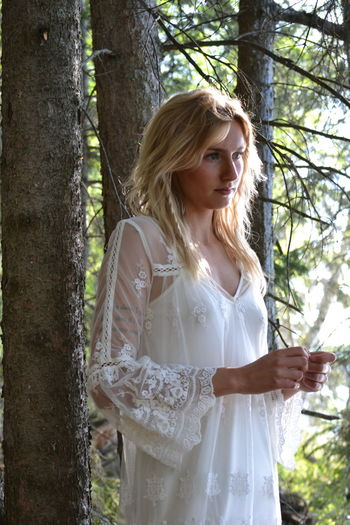 Wilderness Wildlife Beauty In Nature Bride Blond Hair Young Women Tree Wedding Dress Beauty Portrait Beautiful Woman Beautiful People Standing Lace - Textile Lace - Fastener Corset Stockings Sleeveless  Blooming Wavy Hair Sundress See Through