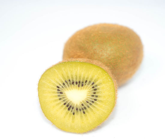 Kiwi fruit on white background And, Antioxidant, Background, Broken, Brown, Cantle, Carb, Closeup, Color, Colour, Cross, Cut, Cutout, Dessert, Diet, Dieting, Drink, Eating, Exotic, Food, Fresh, Freshness, Fruit, Full, Garnish, Glossy, Green, Group, Hairy, Half, Health, Healthcare, Heal Close-up Cross Section Food Food And Drink Freshness Fruit Healthy Eating Kiwi - Fruit No People Ready-to-eat SLICE Studio Shot White Background