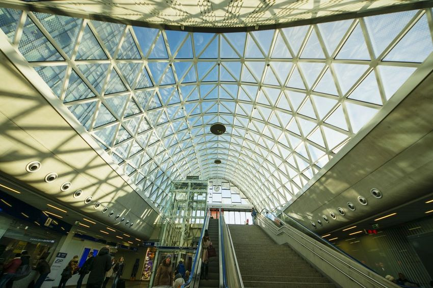 Indoors  Day Architecture Built Structure Streetphotography Railway Station White Structure Geometry Symmetry Pkphotography Arc Arch Eyeem Architecture Triangles Glass Roof Triangle Shape Dynamic Symmetry Glass - Material Geometric Architecture Squares Automatic Doors Entrance Roof