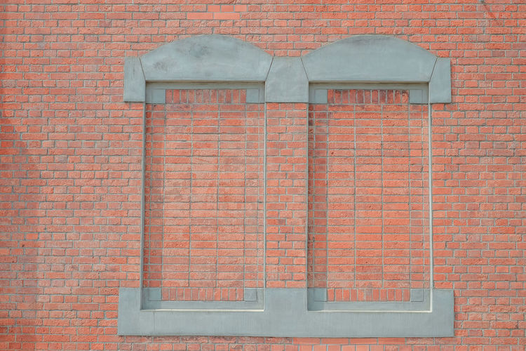 Full frame shot of brick wall with building