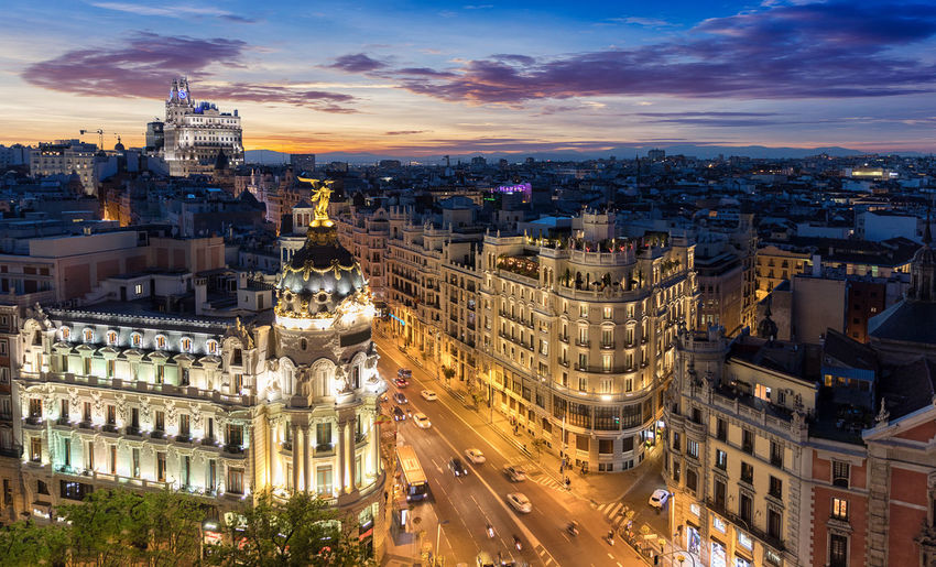 High Angle View Of Gran Via Amidst Buildings During Sunset In City