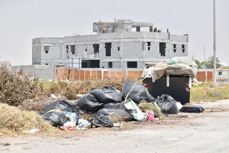 Garbage bin against buildings in city