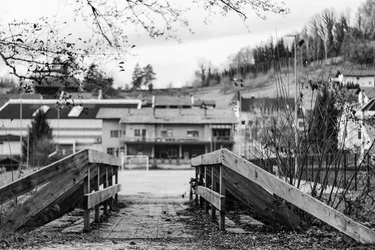 Architecture Blackandwhite Bridge Day Empty Bridge Europe Exploring The Streets Hiking Low Angle View Made For Pedestrians Man Made Structure Monochrome Monochrome Photography Nature No People No People, Outdoors Pedestrians Picket Fence Sky Slovenia Small Bridge Tree Walking Around The City  Wood - Material