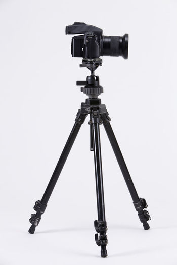 studio shot of high end digital camera on the tripod Camera Photography Multimedia Expertise Professional Occupation Tripod Photograph DSLR Lens Equipment Photographic Theme Photographing Black Nobody White Background Medium Format Camera Photography Themes Technology Studio Shot Camera - Photographic Equipment Indoors  No People Still Life Photographic Equipment Close-up Digital Camera Copy Space Single Object High End Medium Format Filming