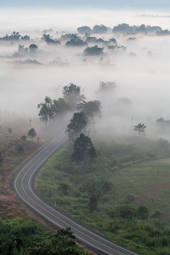 High angle view of road amidst landscape against sky