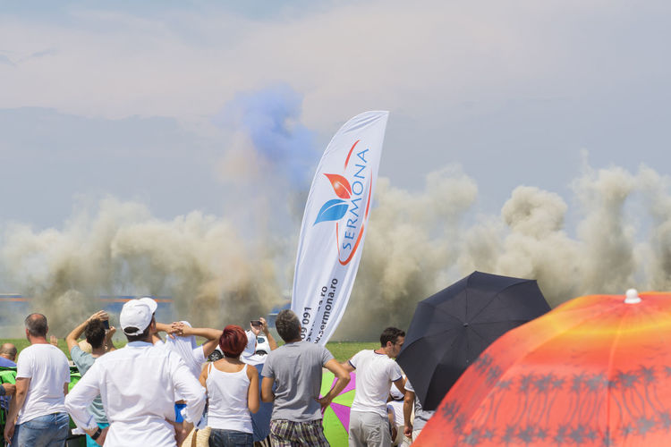 Smoke - Physical Structure People Large Group Of People Sky Airshow Bias2017 Clear Sky The Week On EyeEm EyeEmNewHere Entertainment Event Acrobatic Activity Aerobatics Airshow Flying Hawks Of Romania pYrotechnic Effects