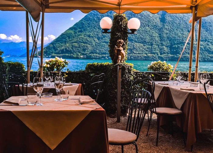 That branch of the lake of Como.. Colors Lake Bellagio Italy Como Lake Followme Like Table Chair Seat Restaurant Place Setting No People Absence Nature Food And Drink Dining Table First Eyeem Photo