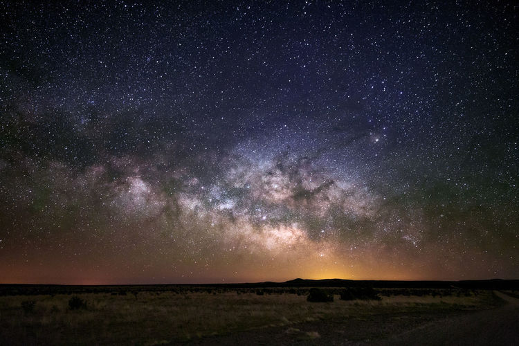 The Milky Way rises above the horizon and into the early summer night sky near Roswell, New Mexico. Astronomy Backgrounds Beauty In Nature Galaxy Landscape Milky Way Nature Night Outdoors Scenics Sky Star - Space Starry Stars Starscape Tranquil Scene Tranquility